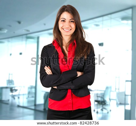 Cute young businesswoman in her office - stock photo