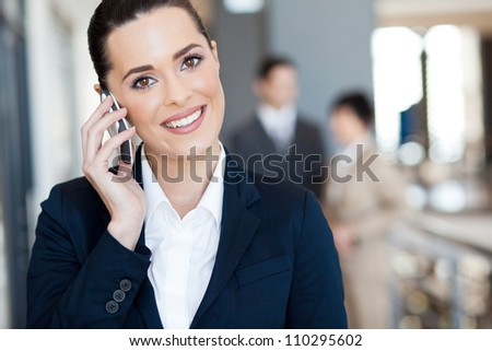 cute young businesswoman talking on cell phone - stock photo