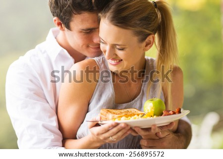cute young couple flirting during breakfast time - stock photo