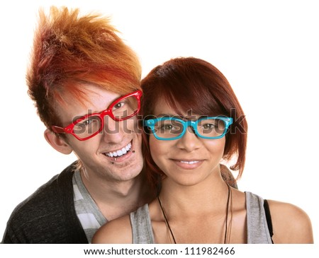 Cute young couple in red and blue glasses over white