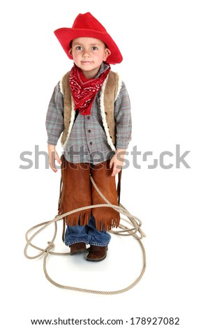 Cute young cowboy playing in tangled rope