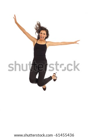 Cute young energetic woman dancing jumping in air - stock photo