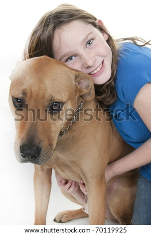 cute young girl hugging dog