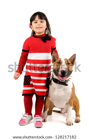 Cute young girl posing with her Bull Terrier