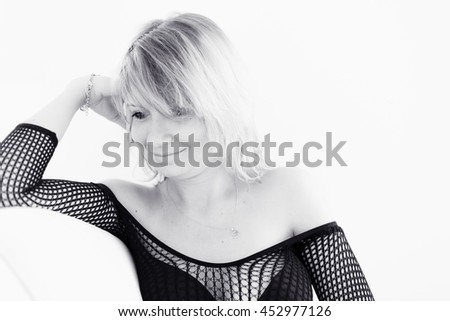 Cute young girl relaxing on couch at home. Hi-key Soft-focus Image - stock photo