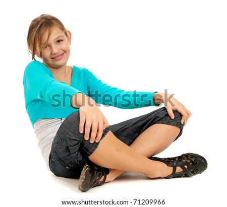Cute young girl resting isolated on white background - stock photo