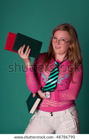 cute young girl with books in studio - stock photo