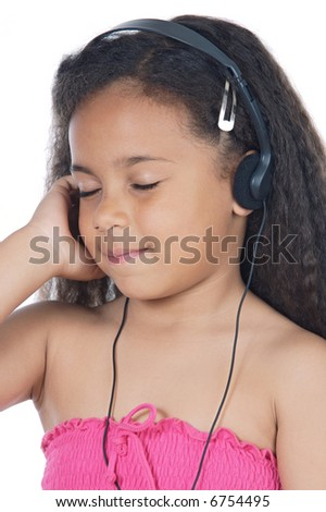 Cute young girl with headphones and eyes closed - stock photo