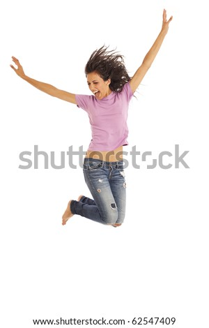 Cute young girl with jeans and pink top jumping energetically - stock photo