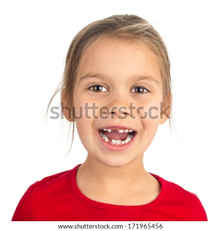 Cute young girl with several teeth missing smiling happily, isolated on white