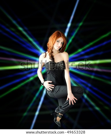 cute young pretty girl in stylish black wear - stock photo