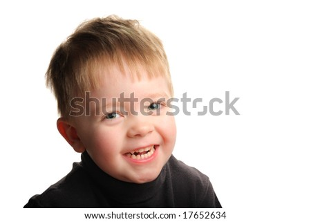 Cute young smiling boy with blond hair and green eyes, isolated on white