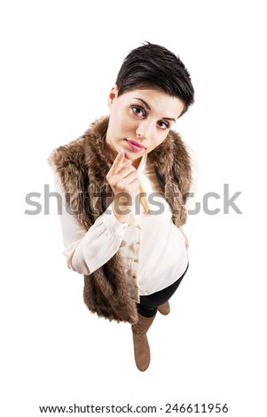 Cute young stylish woman curious looking at camera.  High angle view wide lens full body length portrait isolated over white background. - stock photo