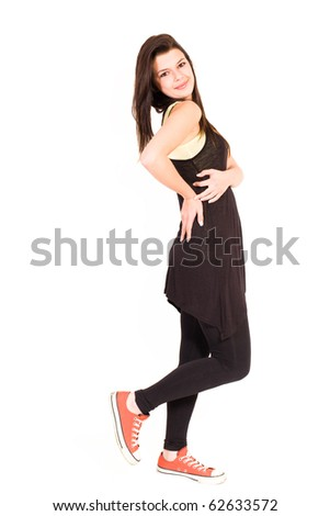 Cute young teen striking poses on white background.