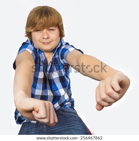 cute young teenager with hands in foreground - stock photo