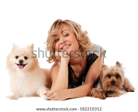 Cute young woman cuddling her dogs while sitting isolated on white - portrait - stock photo