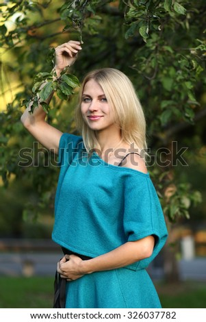cute young woman in park