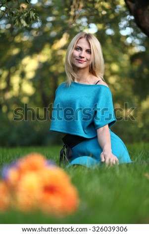 cute young woman in park - stock photo
