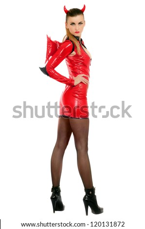 Cute young woman is wearing a sexy devil costume - stock photo