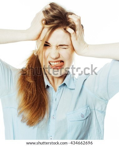cute young woman making cheerful faces on white background, mess - stock photo