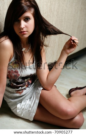 Cute young woman plays with her hair - stock photo