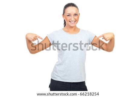 Cute young woman wearing blank gray cotton t-shirt and pointing to her isolated on white background