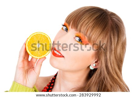 Cute young woman with an orange fruit isolated over white background