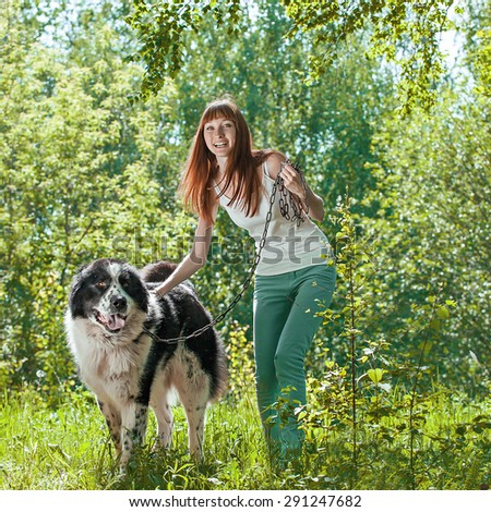 Cute young woman with her Dog in Summer park