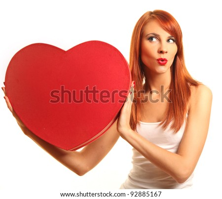 cute young woman with red heart - stock photo