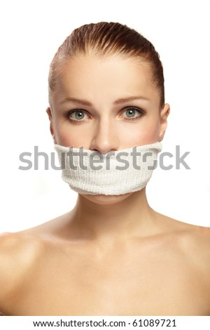 Cute young woman with white band on the mouth - stock photo
