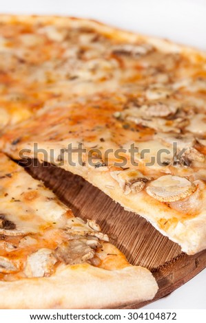 Cuted fungi pizza on the wooden board. - stock photo