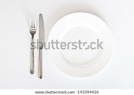 cutlery and plate on white background