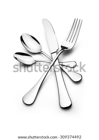 Cutlery arranged in a circle isolated on white