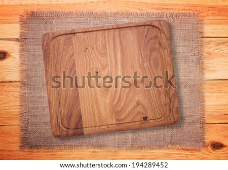 Cutlery on red checkered tablecloth tartan. Wooden table close up view from top. Wooden kitchen cutting board retro. Product pages for installation recipe books menu - stock photo