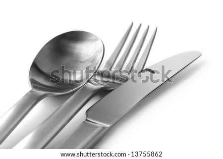 Cutlery, on white, in soft-focus. - stock photo