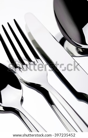 Cutlery set: fork, spoon and knife isolated on white background.  - stock photo