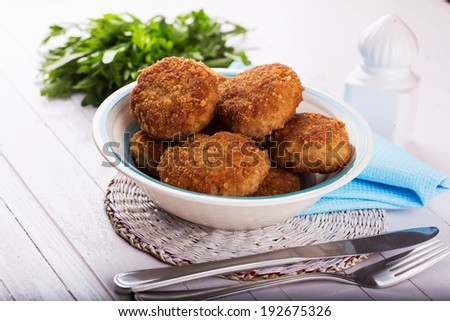 Cutlets on plate  on wooden on table. Selective focus, horizontal. - stock photo