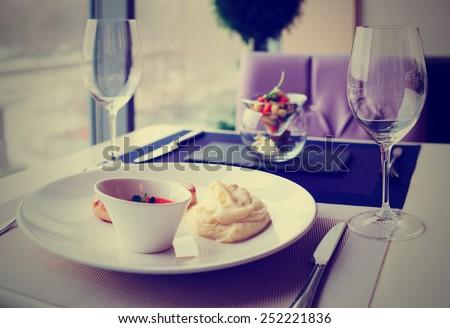 Cutlets, potato mash and vegetable salad on restaurant table, toned image - stock photo