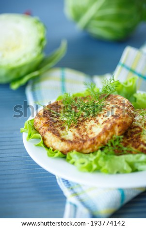 cutlets with cabbage lettuce and dill on a plate - stock photo