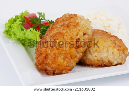 cutlets with herbs and rice on a plate close-up - stock photo