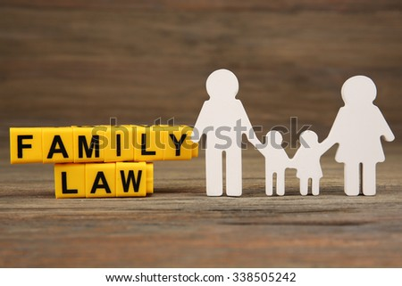 Cutout family and blocks with letters regarding child-custody and family-law concept - stock photo