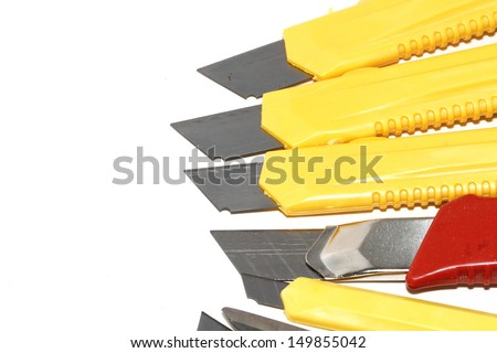 Cutter and scissors on a white background. - stock photo