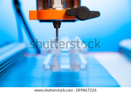 Cutter CNC router and plastic parts of Plexiglas