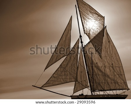 Cutter rigged wooden sailboat in sepia - stock photo