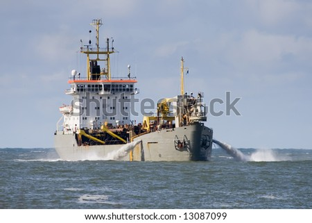 Cutter suction dredger drains water - stock photo