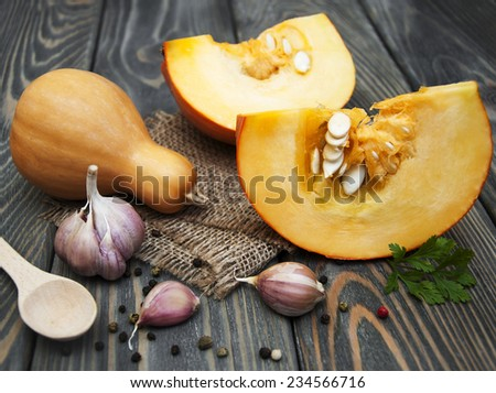 Cutting a pumpkin and vegetables ingredients for soup - stock photo
