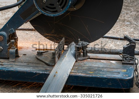 Cutting a triangle metal and steel with compound mitre saw with circular blade