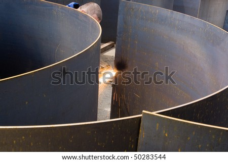 Cutting and preparing sheet metal at an engineering works - stock photo