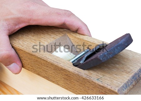 Cutting blade of hand plane/carpentry hand tool/woodworking tool/handyman on white/Man checking hand plane  - stock photo