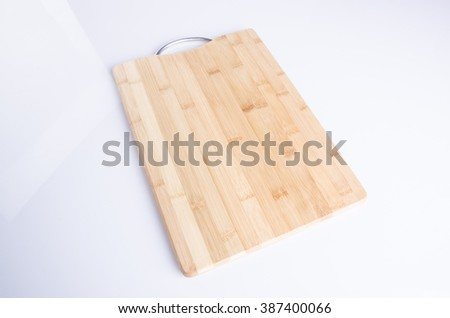 cutting board or wood cutting board on background - stock photo